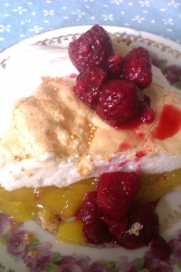 With raspberries and cream