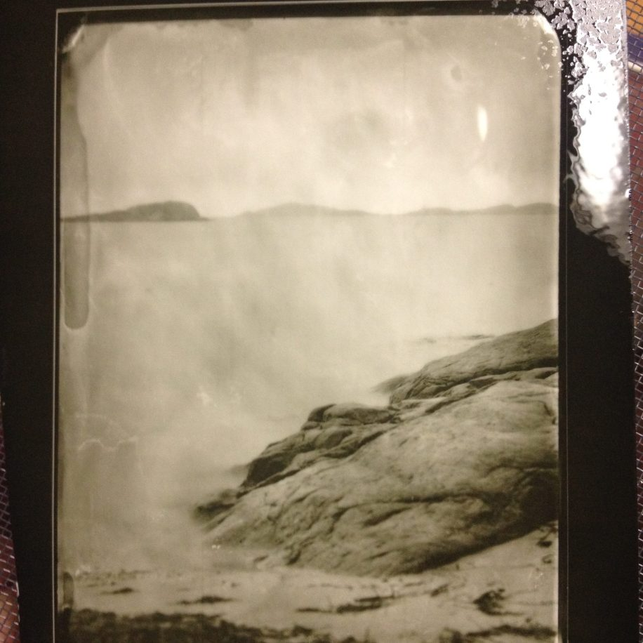 phone picture of drying contact print made from glass negative